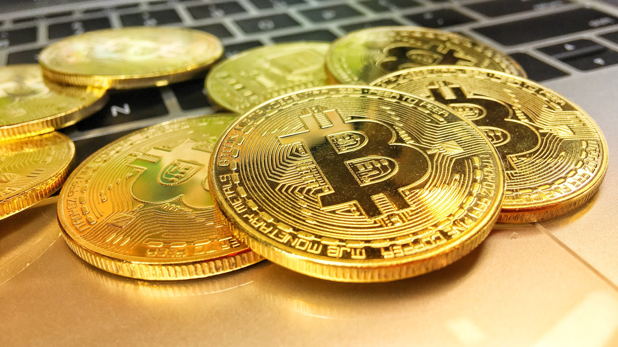 close up on gold bitcoin cryptocurrency blockchain bitcoin mining coins bitcoin business bitcoin logo t20 XzrRBb 1