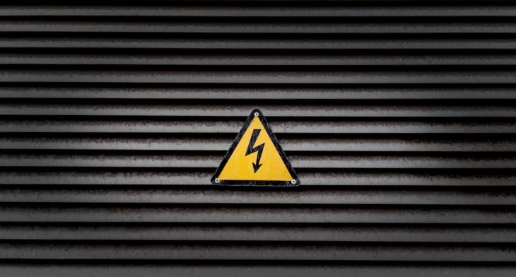 yellow danger sign black striped wall
