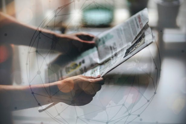 man reading newspaper 2